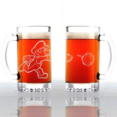 Just when you thought drinking beer couldn't get anymore fun! These high-quality mugs each hold a pint of your favorite beverage and includes an etched image of Mario shooting a fireball that warps around the glass. #supermariobros #supermario #mario #nintendo #merchandise
