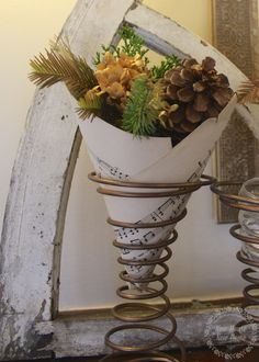 Christmas crafts: sheet music vase made from found bedsprings