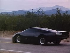 """Dodge Turbo Interceptor, 'The Wraith' You'll catch a rare glimpse of Dodge's scissor-doored concept car """"The Wraith"""" is a feature-length ode to the which is as indestructible as its undead driver! Used Car Prices, Pt Cruiser, Dodge Trucks, Amazing Cars, Awesome, Hd 1080p, Concept Cars, Armor Concept, Exotic Cars"""
