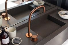 COCOON showroom in Amsterdam | Piet Boon copper design bathroom taps bycocoon.com | Piet Boon® by COCOON design bathroom faucets in raw copper finishing | inox stainless steel mixer and spout | bronze tapware | bathroom design | minimalist bathroom | combined with black modern COCOON vanity | Dutch Designer Brand COCOON