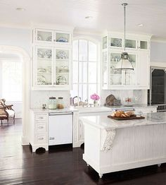 If I could have anything - it would resemble this. Love the marble counters. Not crazy about the flooring, but love the white cabinets, big window, glass fronts, island that looks like furniture. Budget Remodel, Cabinet Remodel, Kitchen Cabinet Doors, Update Cabinets, Kitchen Remodel, Interior Design Kitchen, Home Kitchens, Interior Paint Colors For Living Room, Shabby Chic Kitchen