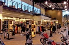 Latus Motors Harley Davidson, Inc., main floor motorcycle showroom and clothing departments, with view of the upper mezzanine level.