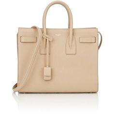 Saint Laurent Small Sac De Jour ($2,890) ❤ liked on Polyvore featuring bags, handbags, nude, beige handbags, beige bag, flat bags, lock bag and yves saint laurent purses