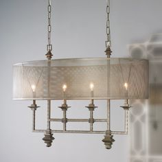 "An oval shade of metal mesh diffuses the light in an alluring way on this over scaled chandelier. Blending styles of industrial, modern and transitional creates an edgy architectural focal point over your dining table or island. 4x60 watt candelabra lamps required. 14 lbs.(26.75""Hx35.5""Wx20""D)Canopy dimensions: 24""L x 4-7/16""WSupplied with 10' of chain."