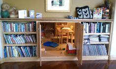 secret playroom through cabinet doors in bookshelf? It could be made into a safe room by simply making a false door look like part of the bookcase. would be awesome for the playroom into the closet Hidden Spaces, Hidden Rooms, Hidden Panic Rooms, Creative Bookshelves, Room Deco, Secret Space, Cool Secret Rooms, Secret Rooms In Houses, Safe Room