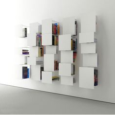 Vertical, wall-mounted bookshelves composed of 5 panels in various dimensions and depths. Available in white or black powder-coated steel. Custom RAL color available upon request. Dimensions: 35 W x 35 D x 154 cm H / x x Wall Mounted Bookshelves, Bookcase, Ikea Furniture, Furniture Design, Storage Shelves, Shelving, Living Divani, Tidy Room, Regal Design