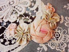 exquisite antique ribbon work cabochon roses