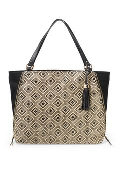 Transition from day-to-night with this black leather & neutral diamond pattern handbag from Stella & Dot. Go zipped or unzipped with The Switch everyday bag.