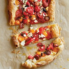In this tomato feta tart, store-bought puff pastry is treated to a simple topping of tomatoes, cheese and herbs, then baked until golden brown and flaky.