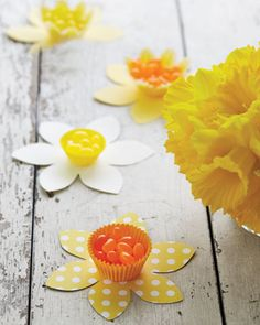 Easter Ideas - perhaps thread cellophane filled with candies through a hole-punched hole in centre of flower and tape/tie/attach somehow to stick. Like a daffodil head filled with candy, with petals and a stem.