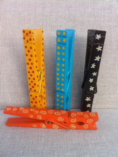 Set of four hand painted clothespins on Etsy, $7.00