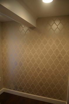 Wall stencil tutorial... What if we did a stencil on the laundry room wall, white and the color we ultimately paint the kitchen? It could be subtle but a little more interesting, and pull the rooms together.