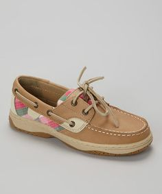 Walking the line between classic and contemporary is a cinch for these boat shoes. Spiffed up with pattern accents and a sturdy sole, this slip-on pair will bring comfort and style to a little one's look.