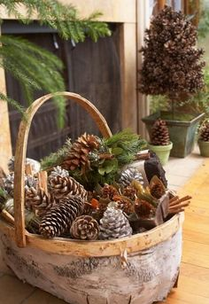 Pinecones and sprigs of fresh or artificial greens fill a woodsy basket, making a totally totable accent. More pinecone decorating ideas: http://www.midwestliving.com/holidays/christmas/pinecone-crafts-and-decorations/?page=5