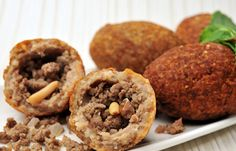 Kibbeh...cracked wheat & meat fritters, stuffed with ground meat, pine nuts and spices...these are labor intensive and a bit hard to make, but delicious...kd