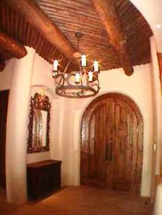 SW Custom Home Territorial Home southwestern Custom Home Santa Fe Home, Hand Hewn Beams, Fireplace Mantels, Building Materials, Custom Homes, Interior And Exterior, Wood, Places, Design