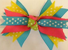 Idea: a few wide and narrow ribbons tied into to cute bow