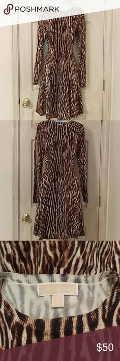 Michael Kors Long Sleeve Sweater Dress Animal print in neutral shades of creams and browns. Full long sleeves with princess/fit and flare silhouette. Round neckline and gold tone Michael Kors plate on the back of the neck. Excellent condition, no holes or snags. Made from 56% cotton, 25% rayon , 17% nylon, 2% spandex. Smoke free home. MICHAEL Michael Kors Dresses Long Sleeve