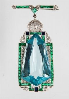An art deco aquamarine, diamond, emerald, sapphire and platinum brooch/pendant