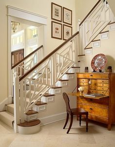 This fretwork bannister is beyond. This must be a a back staircase as well, considering the view of the front door from this space.