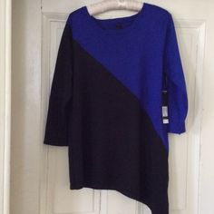 """Top, blue and black Large, NWT New top, L, XL fit, with tags never worn, Isela brand, and gnw. Very attractive with diagonal coloration. Electric blue, coal black colors. Long.28"""" Isela Tops"""