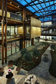 "Completed in 2012 in Seattle, United States. Images by Lara Swimmer, Benjamin Benschneider. Federal Center South Building 1202 is the ""redevelopment"" of an existing warehouse (Building located at Federal Center South in Seattle. Biophilic Architecture, Green Architecture, Architecture Design, Concept Architecture, Classical Architecture, Interior Garden, Interior Design, Atrium Design, Lobby Design"