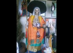 Death a la Mexicana, Santa Muerte chapel, Santa Ana Chapitiro, Michoacan.   Saint Death (Santa Muerte) is a skeletal folk saint whose cult has proliferated on both sides of the border over the past decade. The Grim Reapress (she's a female figure) has rapidly become one of the most popular and powerful saints on both the Mexican and American religious landscapes. She appeals to millions of Mexicans and Latin American immigrants