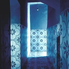 A Moroccan tiled hallway in Agnès Emery's house in Marrakech. The scale of the pattern is so astonishing. As is the blue! Marie Claire Maison Magazine.