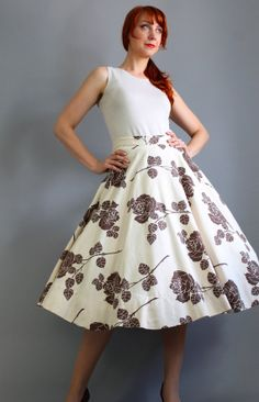 Hey, I found this really awesome Etsy listing at https://www.etsy.com/listing/157781914/1950s-cream-chocolate-brown-roses-print