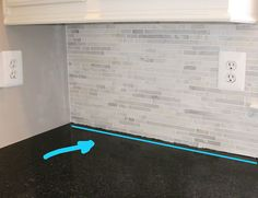 How to install a marble backsplash - silicone on corner of counters and backsplash