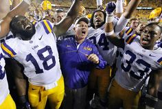 Tigers head coach Les Miles celebrates with his team after beating the Gamecocks. (Reuters)