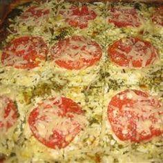 Pesto Pizza Allrecipes.com.  Ready made crust, pesto, ricotta, romano, parmesan, and tomatoes....yum.