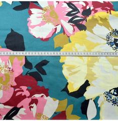 Cotton sateen from John Kaldor in a pale teal blue with a floral design.