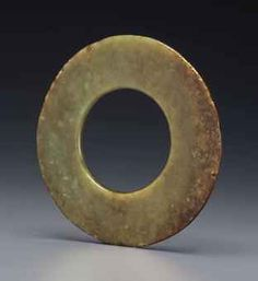 AN OLIVE-GREEN AND RUSSET JADE HUAN DISC NORTH-WEST CHINA, LATE 2ND-1ST MILLENIUM BC  Price Realized      $8,125 (Set Currency)  Estimate      $7,000 - $10,000  Sale Information      Sale 2726 —     Fine Chinese Ceramics and Works of Art     19 - 20 September 2013     New York, Rockefeller Plaza Christie's