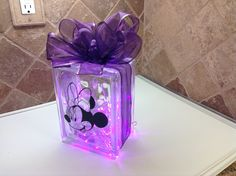"""SPECIAL ORDER """"MINNIE MOUSE"""" LASER ETCHED WITH PURPLE RIBBON EMBELLISHMENT AND PINK LED BATTERY OPERATED LIGHTS. Laser etching by Lavene & Co"""