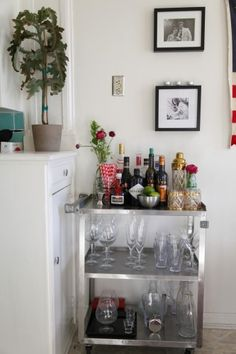In this article she says her biggest splurge is keeping her bar cart stocked... idea! but lets paint that baby gold!