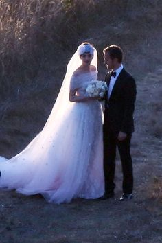 Anne Hathaway in a custom Valentino dress at her wedding in Big Sur.
