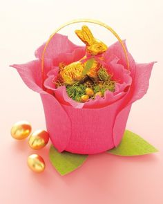 A frilly alternative to a traditional basket, this version is made of folds of pink crepe paper and a plastic bucket.