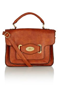 This bang on trend satchel bag has single handle to the top and a longer strap to wear over one shoulder or across the body. There is a flap-over and fastening with a turn lock and multiple pockets to the interior.