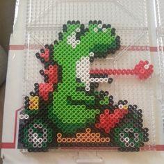 sandylandya@outlook.es  Yoshi Mario Kart perler beads by perlerboss