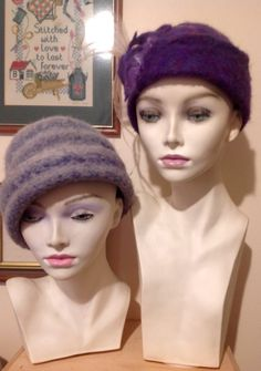 My hand knitted and wet felted Purple hat.with Coffin Bay emu feathers