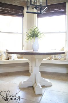 Build a custom round table for only $75 in lumber with free printable plans and easy-to-follow tutorial from www.shanty-2-chic.com.