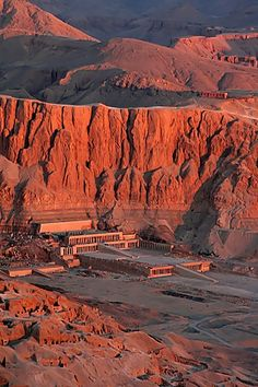 Hatshepsut's Mortuary Temple, located at the base of the cliffs of Deir el-Bahri, served as a major religious center for festivals of Amun during the New Kingdom. Her temple is just one part of a sacred alignment of sites in ancient Thebes connecting all the major temples with perfect geometric precision.