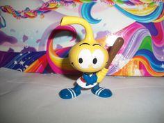 Vintage pvc figurine snorks all star baseball yellow cool 80s toy. $2.99, via Etsy.