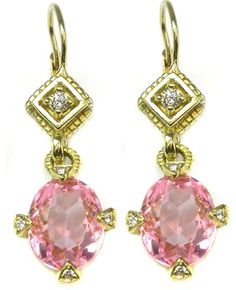 10ct Oval Kunzite Diamond Earrings.  I could never pull off the size of the earrings, but so often I just LOVE looking!