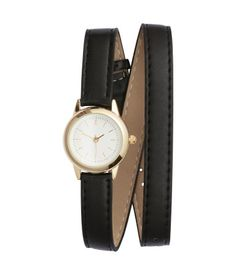 Metal wristwatch with a narrow, adjustable strap in imitation leather that doubles around wrist. Width of strap approx. 1/2 in.
