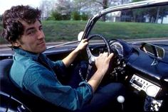 Bruce Springsteen driving his classic Corvette