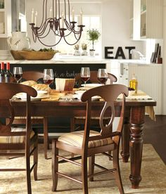 I love the chunky, farmhouse style with chalkboards and the 'eat' sign. This is our kitchen dining style to a tee. Pottery Barn Kitchen, Rustic Kitchen, Kitchen Decor, Kitchen Design, Kitchen Ideas, Dining Room Design, Dining Room Table, Wood Table, Dining Set