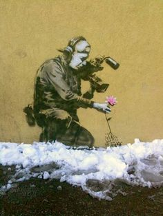 Banksy.... wonder if hubs would dress up like this for halloween... we could be Banksy graffiti