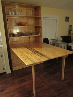 Folding kitchen table with storage space.